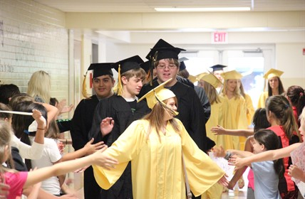 CCHS graduates walk through Cartmell's halls.