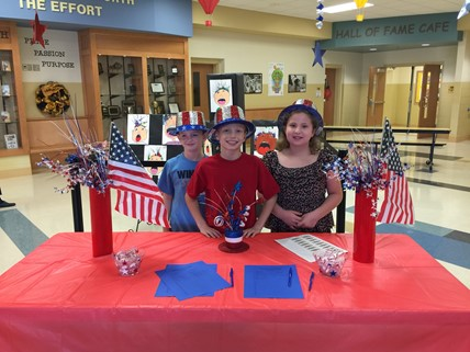 Cartmell students welcoming visitors for the Veterans Day Assembly