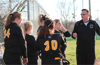 Softball coach talking to team members